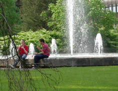 Students sitting near a fountain in Ireland.